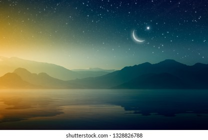 Ramadan Kareem background, rising crescent and stars above mountains and serene sea. Elements of this image furnished by NASA
