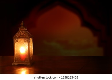 Ramadan Kareem background.Ramadan lantern on wooden  table