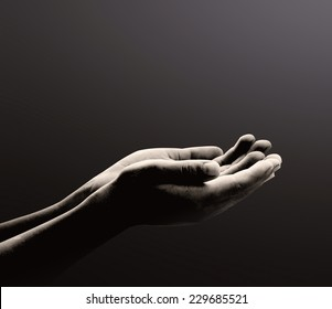 Ramadan kareem concept: Black and white prayer hands open two empty hands with palms up to pray God