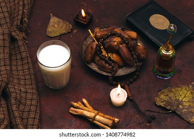 Ramadan kareem concept with  dates and holy book of muslims and rosary, siwak, perfume, candle and scarf