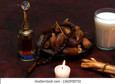 Ramadan kareem concept with  dates and and rosary, siwak, perfume, candle