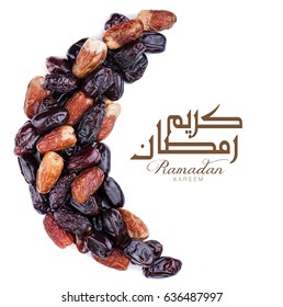 Ramadan kareem with dates arranged in shape of crescent moon.