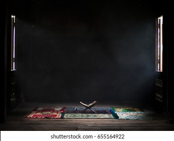 Ramadan kareem with Holy Quran on wooden stand