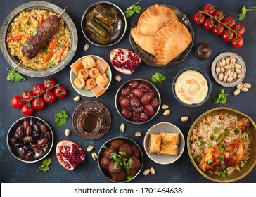 Ramadan kareem Iftar party table with assorted festive traditional Arab dishes, sweets, dates. Eid al-Fitr mubarak evening grand meal, top view. Islamic holidays food concept, Ramadan feast