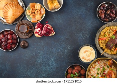 Ramadan kareem Iftar party table with assorted festive traditional Arab dishes, sweets, dates. Eid al-Fitr mubarak evening grand meal, top view. Islamic holidays food, Ramadan feast, space for text