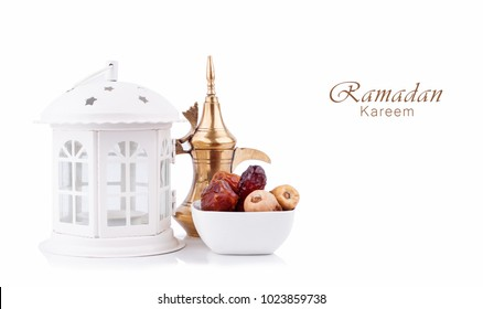 Ramadan kareem with lantern , arabic coffee pot and dates