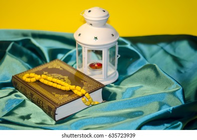 Ramadan Kareem, Ramadan lantern With a Holy Quran and Praying beads, Lamps photography, Ramadan Festival, Generous Ramadan yellow background