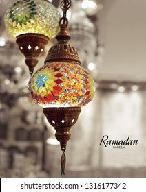 Ramadan Kareem meaning Blessed Ramadan with beautiful lanterns hanging