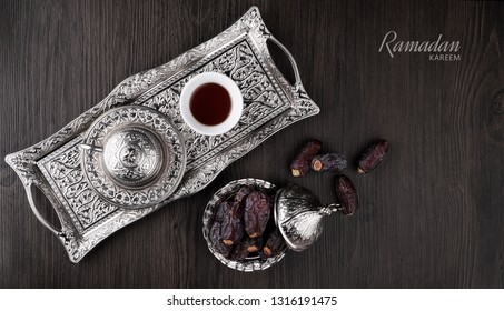 Ramadan Kareem meaning Blessed Ramadan with dates fruit and arabic coffee cup