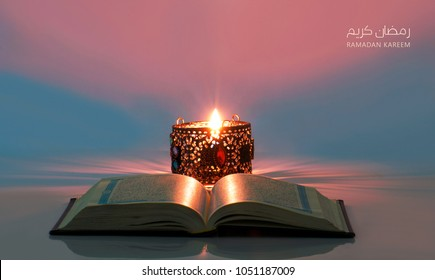 Ramadan kareem meaning blessed ramadan with holy Quran and lantern lit