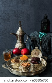 Ramadan kareem with premium dates ,nuts and Arabic tea. Festive still life with oriental ramadan lantern and iftar food concept.