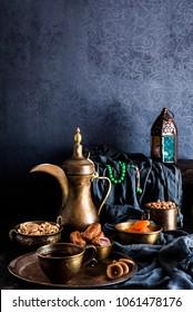 Ramadan kareem with premium dates,nuts and arabic coffee. Festive still life with oriental ramadan lantern and iftar food concept.