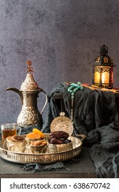 Ramadan kareem with premium dates,nuts and arabic tea. Festive still life with oriental ramadan lantern and iftar food concept.