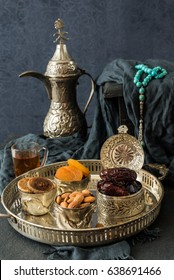 Ramadan kareem with premium dates,nuts and Arabic tea. Festive still life of iftar food concept.