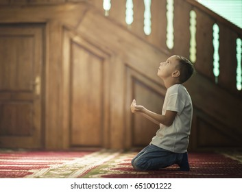 Ramadan Kareem,The Muslim prays in the mosque, the little boy prays to God,Peace and love in the holy month of Ramadan,lifestyle concept