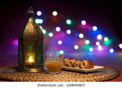 Ramadan lantern with Arabian coffee and dates