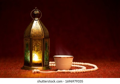 Ramadan lantern with Arabian coffee and rosary