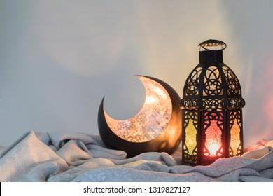 Ramadan Lantern, and a copper crescent on satin cloth