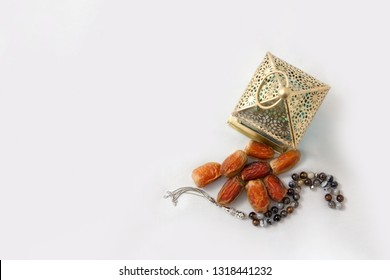 Ramadan Lantern, dates fruit, and rosary beads isolated - top view