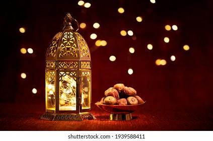 Ramadan lantern with dates at night