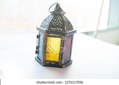Ramadan Lantern with glittering background close up with a nice bokeh