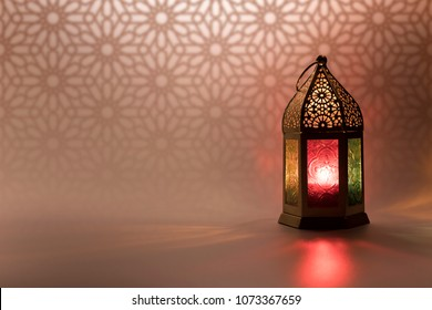 Ramadan Lantern in low light mode with arabesque background