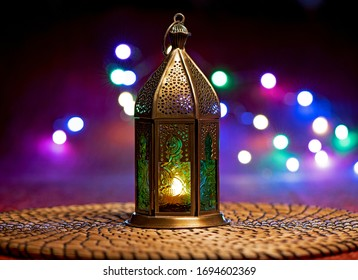 Ramadan lantern at night with lights in the background