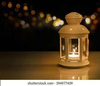 Ramadan lantern with night lights. Ramadan mood at night with light decoration in the background.