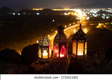 Ramadan lanterns kept on top of the hill with a background of the valley in which the city is illuminated.