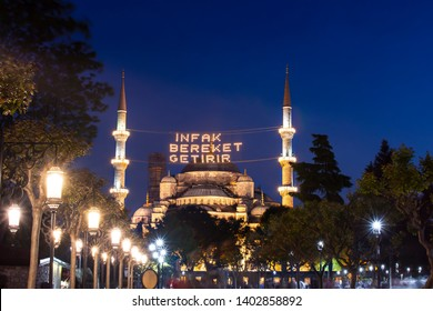 "In Ramadan month Islamic message lettering (Mahya) hanging on Blue Mosque in Istanbul,Turkey. Mahya says ""Infak bereket getirir"" in English it's meant ""Help is bringing blessing""."