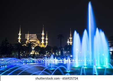 In Ramadan month Islamic message lettering hanging on Blue Mosque's mahya in Istanbul, Turkey. Mahya is an enlightenment arrangement during ramadan nights between two minarets.