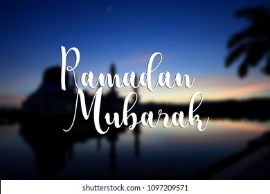 Ramadan Mubarak message with mosque blurred at background
