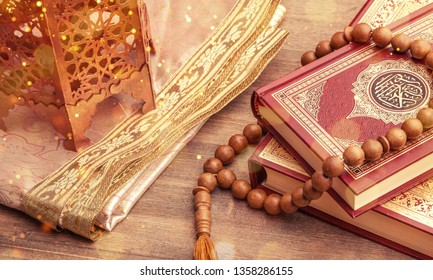 Ramadhan objects. Holy Quran and wooden cheekbones