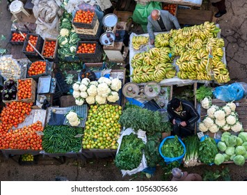 Ramallah, Palestine, January 12, 2011: A man selling fresh fruits and vegetable on a market in the centre of Ramallah.
