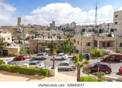 RAMALLAH, WEST BANK PALESTINE - JUNE 10, 2016. Traffic jam on a street in the center of Ramallah in the sunny day