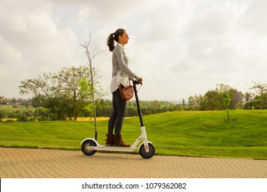 Ramat gan Israel, April 21 2018, A young woman riding an electric scooter in the park