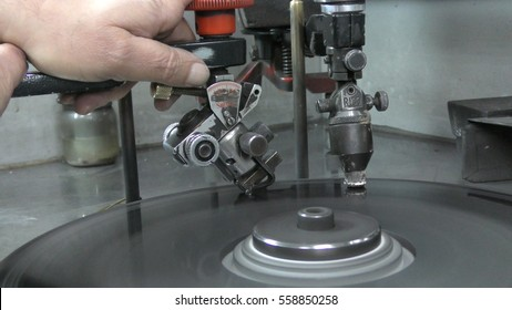 RAMAT GAN, ISRAEL, FEBRUARY 16, 2016: A polisher brillianteers the final facets of a diamond attached to a dop on rotating cast iron lap, during International Diamond Week