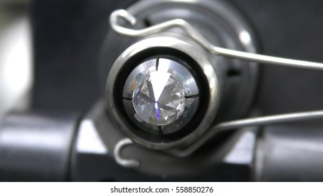 RAMAT GAN, ISRAEL, FEBRUARY 16, 2016: A diamond held by dop is polished on rotating automatic cast iron lap, during International Diamond Week