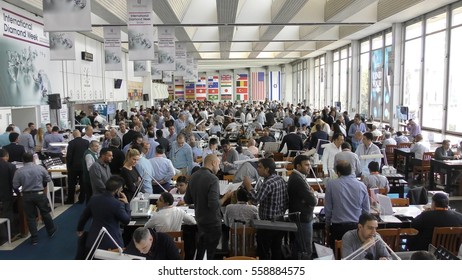 RAMAT GAN, ISRAEL, FEBRUARY 16, 2016: Israeli companies exhibiting their goods on the Diamond Exchange trading floor, the largest in the world. Traders negotiate and shake hands, exchanging diamonds