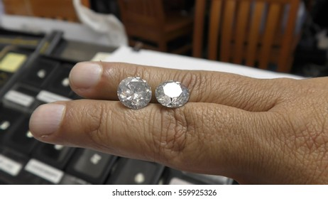 RAMAT GAN, ISRAEL, FEBRUARY 16, 2016: A trader displays two perfectly shaped brilliant diamonds in the Diamond Trading Hall Bursa during International Diamond Week, where buyers and sellers meet