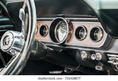 RAMAT-GAN, ISRAEL - OCTOBER 6, 2017: 1966 vintage Ford Mustang interior - steering wheel with logo and dashboard