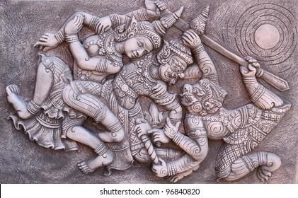 Ramayana bas-relief sculpture of Tosakan (ten face) giant , Thailand