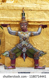 ramayana thai tradition demon statue which support golden chedi