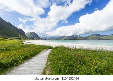 Rambergstranda beach on Lofoten islands. Beautiful sandy beach and azure water. Norway.
