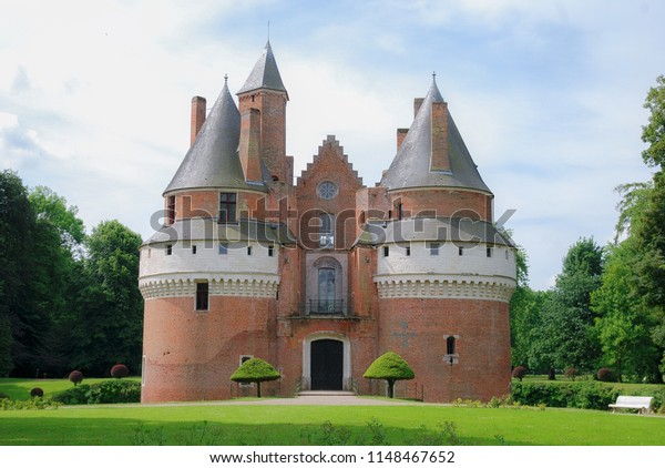 Rambures City, Somme / France - June 17th 2009: View from the entrance of the Rambures Castle, front view of the building. This Castle build in bricks during middle age, France.