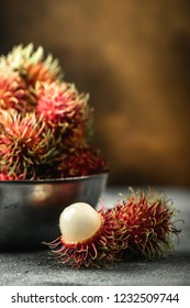 Rambutan exotic fruits from tropical countries on table. Sweet translucent flesh. Healthy food with vitamin