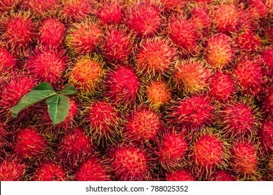Rambutan with leaf, Red peel of rambutan, Delicious rambutan