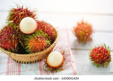 Rambutan peeled in a basket on table background / Fresh rambutan summer fruit from garden in Thailand