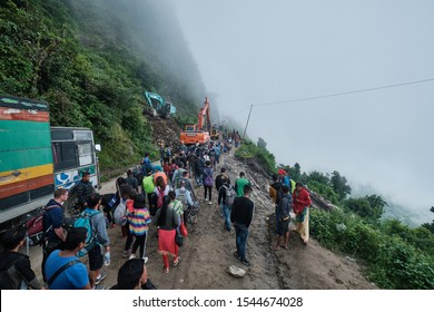 Ramche - Nepal, September 20 2019. Torrential rain had caused a landslide at a major road linking Langtang Valley to Kathmandu. Crowds crossing on foot over the landslide during a pause in recovery.