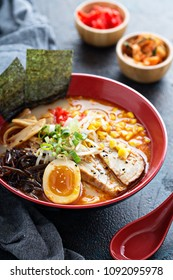 Ramen bowl with noodles, pork, boiled egg and vegatables
